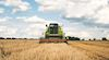 Combine harvester harvesting a field