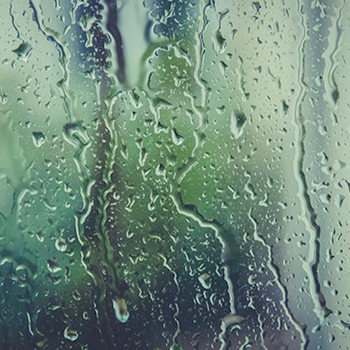 Window pane with water drops