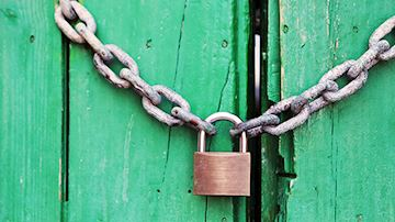 Green shed with chain and padlock