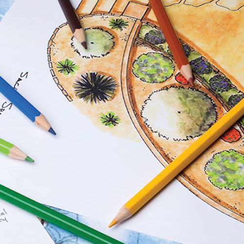 Illustration of garden design with coloured pencils scattered around