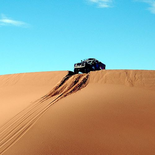 Landrover off roading along sand