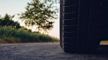 Tyre of car and surface of road