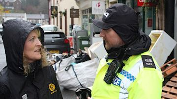 Abbleby agent Amanda Wallbank with police officer following flooding