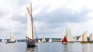 Sailing boats on the water at the Falmouth Classics