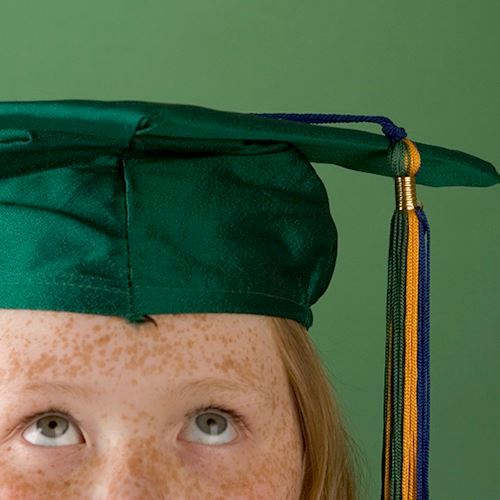 Student in green mortarboard
