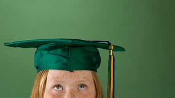 Student in green mortar board
