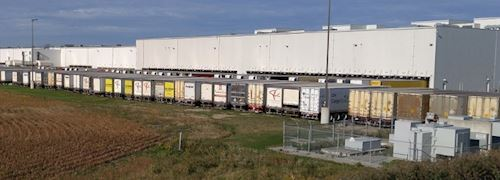 A large distribution centre with 32 lorries lined up