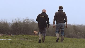 NFU Mutual Agent in field with farmer and gun dog