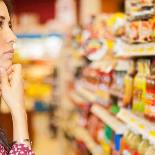 Woman grocery shopping looking at products