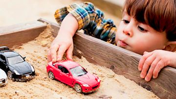 Child playing with car toys